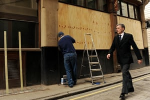 G20: A tailors shop is boarded up near the Bank of England in central London