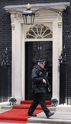 G20: An armed police officer passes the front of 10 Downing Street