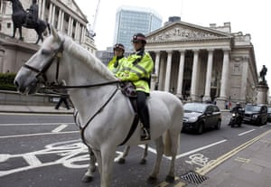 G20 preparation: Mounted police officers patrol in front of the The Bank of England