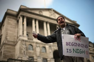 G20 preparation: A man protests about capitalism outside The Bank of England