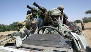 Darfur atrocities: Fighters of the Sudanese Justice and Equality Movement on Sudan border.