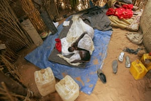 Darfur atrocities: A woman holds her baby at  ZamZam camp, at Fasher, north Darfur