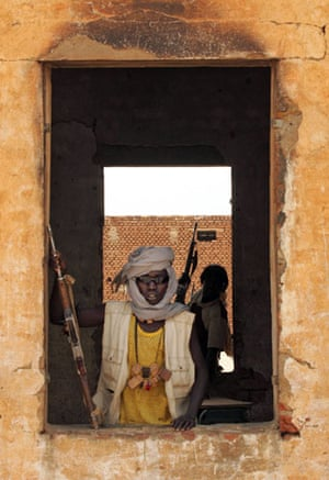 Darfur atrocities: Rebels from the Sudan Liberation Movement occupy a deserted house in Tina.