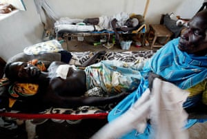 Darfur atrocities: A Sudanese man with bullet wounds from fighting at an MSF clinic.