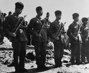 Tibetan uprising: 6 April 1959: Communist Chinese troops stand guard near the Tibet border