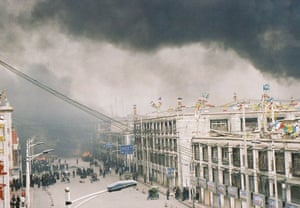 Tibetan uprising: 14 March 2008: Tibetan protesters burn motorcycles, and goods from shops