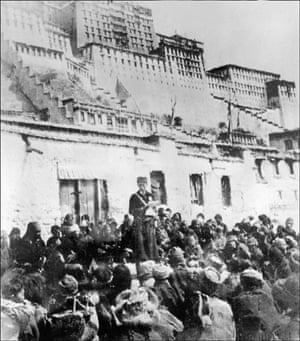 Tibetan uprising: 1959: A Chinese officer addresses Tibetans in front of the Potala Palace