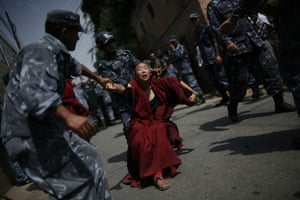 Tibetan uprising: 30 March 2008: A Tibetan Buddhist nun is detained by police in Nepal