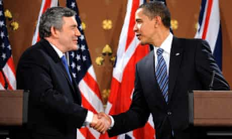 Barack Obama and Gordon Brown shake hands at a press conference
