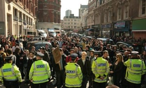 G20 protesters with police standing guard in central London