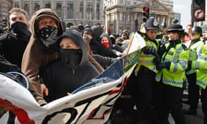 Anti-capitalist and climate change activists demonstrate in the City of London ahead of G20 summit.