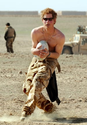 Prince William and Harry: Prince Harry practices his rugby skills in Afghanistan