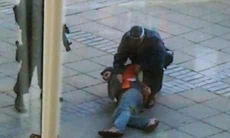 Armed anti-terrorist police apprehend a suspect