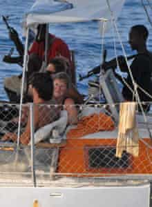 Armed pirates and their hostages are seen aboard the French yacht Tanit.