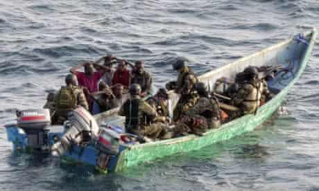 Suspected pirates are seen after they were intercepted by marine commandos of the French Navy