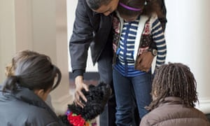 President Barack Obama pets Bo, a six-month old male Portuguese water dog