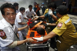 Thailand protests: Medical workers transport an injured supporter of ousted Thai PM.