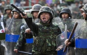 Thailand protests: Thai soldiers shout insults at anti-government demonstrators, in Bangkok.