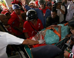 Thailand protests: Thai hospital officials carry a injured man