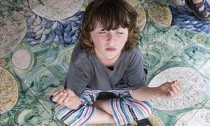 Child in meditation pose