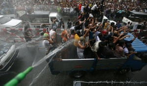 Burma water festival: Locals in vehicles get sprayed at Burma's new year water festival.