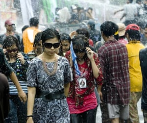 Burma water festival: Young people are sprayed during the annual water festival in Rangoon, Burma