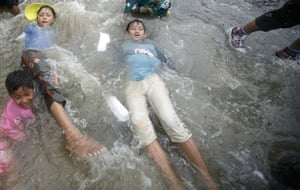 Burma water festival: Children play in water during Thingyan, Burma's new year water festival.