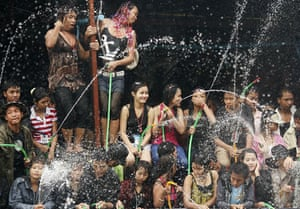 Burma water festival: Locals spray water during Thingyan, Burma's new year water festival.