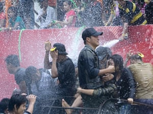 Burma water festival: Young people are sprayed during the annual water festival in Burma.