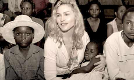 Sepia publicity photo of pop star Madonna with Mercy