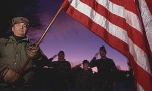 Wolverines militia members carry American flag during