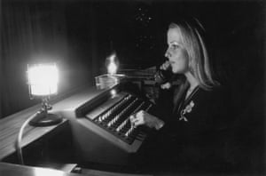 Three day week: Telephonist working by lamplight during the three-day week, December 1973