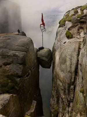 Eskil Ronningsbakken: Ronningsbakken balancing on a chair above the famous Kjaerag Bolten rock