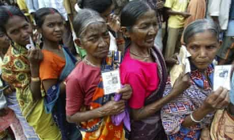 Indian elections: villagers wait in queue to cast their votes