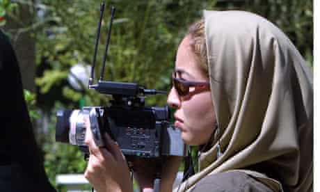 Jailed US-Iranian journalist Roxana Saberi taking footage in Tehran