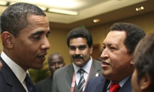 Barack Obama greets Hugo Chavez