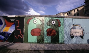 Thierry Noir head painting on the Berlin Wall