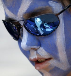 24 hours in pictures: New York, USA: New York Yankees fan Michael Besson looks down at a ball.
