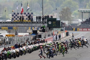 24 hours in pictures: Le Mans, France: Riders run to their motorbikes.