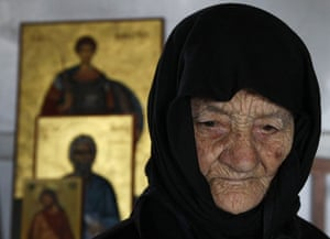24 hours in pictures: Dipkarpaz, northern Cyrpus: Despina, a nun lights candles for Easter.