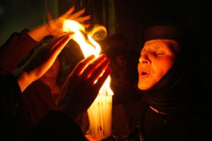 24 hours in pictures: Jerusalem, Israel: Orthodox Christian pilgrims with candles