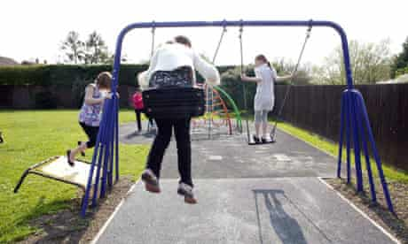 Children and staff in the playground of a children's home in Chelmsford, Essex