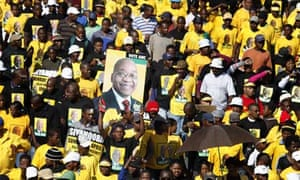 Crowds hold up pictures of Jacob Zuma at the final ANC rally before the election yesterday
