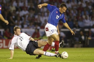 Hot headed Rooney: Rooney hacks down Djordevic