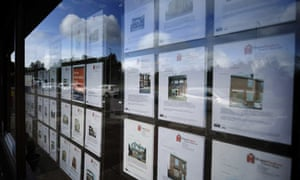 Budget: Property details of houses for sale in the window of a Homefinders esate agents