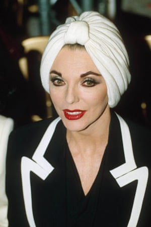 Joan Collins style icon: Joan Collins wearing a turban at the Hartnell fashion show in 1991.