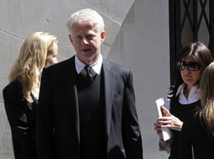 Clement Freud funeral: Richard Curtis and his wife Emma leave the funeral of Clement Freud