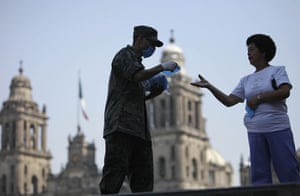 Swine flu: soldier hands out surgical masks during swine flu outrbreak in mexico city