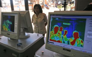 Swine Flu Outbreak: Arriving passengers are monitored at Ngurah Rai Airport in Bali, Indonesia
