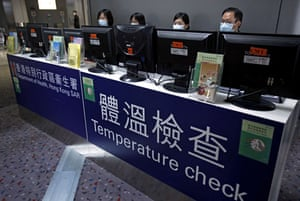 Swine Flu Outbreak: Health workers in Hong Kong check the temperatures of incoming passangers